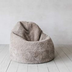 Our sumptuously soft New Zealand sheepskin beanbags are perfect for lounging and feature a durable leather base. Faux Fur Bean Bag, Leather Sofa, Soft Furnishings, Home Accessories, Bean Bag Chair, Beautiful Homes, Taupe, Bedroom Decor, Curly