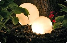 Christmas lights in inexpensive opaque shades for cheap outdoor/garden lighting idea.