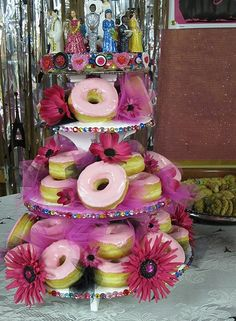 This was my beautiful donut wedding cake. The actual donuts only cost 25 bucks. My cake topper was glittered and pieced together for aout 75 bucks. All in all a cheap wedding cake... and much more interesting! : )