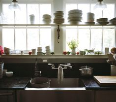 Open shelving and white dishes.  Photo by Katherine Wolkoff for Real Simple