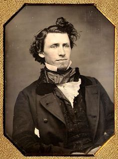 A gentleman with self-confidence...1850s. Undeniably, he is a bit of a dandy. The style of long front hair that is tied in a topknot as here, or flipped to the front on the side as in other pics must have been a quickly passing fad.