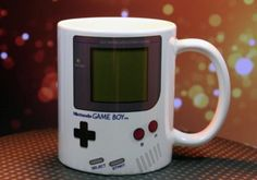 Power up your mornings with a dose of caffeine by having your morning cup of Joe in the Nintendo Game Boy coffee cup. This ceramic mug's nostalgic Nintendo theme makes it ideal for every gamer looking to charge up their batteries for the long day ahead. Game Boy, Deco Gamer, Small Game Rooms, Cafe Cup, Gamer Gifts, Nerd Gifts, Birthday Diy, Nintendo Games, Ceramic Mugs