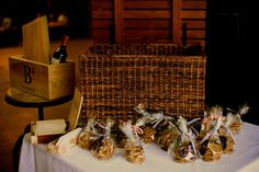 """For the favors, we took Pepperidge Farm cookies and put them in a clear bags. We used a striped ribbon and some custom made stickers from Zazzle the said """"Eat Drink Marry"""". The wooden box has a bottle of Burgundy and a sealed love letter from each to the other (& from guests). We will enjoy it on our 10th anniversary."""