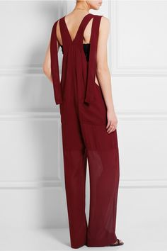 Burgundy crepe  Snap-fastening shoulder straps, button fastenings along sides 100% viscose Dry clean  Made in Italy