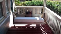 Porch swing with pallets and crib mattress