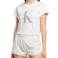 Calvin Klein Women CK One T-Shirt/Short PJ Set, Pride Colours Mini CK One Logo Print  Calvin KleinCK One T-Shirt/Short PJ Set, Pride Colours Mini CK One Logo Print Set Includes Top / Bottoms and carry bag The Top Features Bold CK One Logo on the chest CK Logo waistband and Repeat Logo in Pride Colours on matching button front bottoms 96% Cotton / 4% Elastane Pride Colors, Ck One, One Logo, Front Bottoms, Carry Bag, Pj Sets, Sleepwear Women, Calvin Klein Women, Lounge Wear