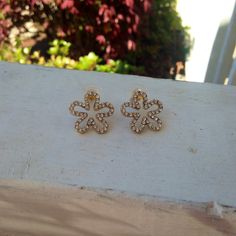 Gold flower outline stud earrings with by SaltwaterBliss on Etsy