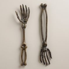 Skeleton Hand Servers, Set of 2 | World Market I just wish they were closer to being anatomically correct... or that I needed serving forks.