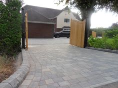 Tegula driveway by Charles William Paving & Landscapes