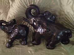 Pair of Black ceramic trunk up African by JacquieAndJacque on Etsy, $35.00