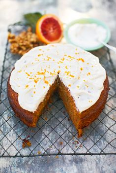 Don't be intimidated by the fact this creation comes from a celebrity chef. (Hat tip to British culinary icon Jamie Oliver!) Walnuts give this easy carrot cake recipe a hint of nutty flavor as well as a pleasant crunch. A frosting made with sour cream and oranges adds a tangy twist. #carrotcake #carrotcakerecipes #bestcarrotcakerecipes #easter #springdesserts #bhg Carrot Cake Bars, Carrot Spice Cake, Homemade Carrot Cake, Easy Carrot Cake, Tropical Carrot Cake Recipe, Classic Carrot Cake Recipe, Sour Cream Frosting, Spring Desserts, Easter Recipes