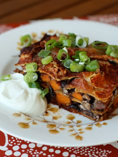Black Bean and Sweet Potato Enchilada Bake. This is a great alternative to overly cheesy enchiladas. It still has a bit of diary, but that can easily be adjusted by using cashew cheese or a store bought vegan alternative. #eatthisnotthat