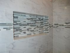 Custom recessed niche in shower for shampoo with glass/stone linear mosaic tiles