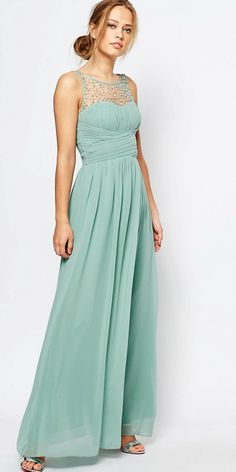 Sage green bridesmaid dress. A floor length pale green bridesmaid dress with embellished neckline.