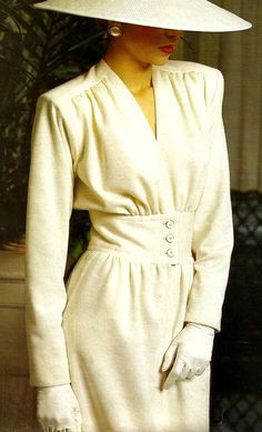 This 1984 elegant winter white outfit with matching hat by Yves Saint Laurant is…