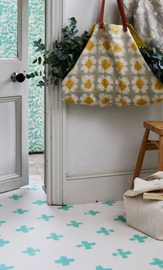 Make an entrance with this playful yet stylish pattern flooring. This cross design displays a simple elegance that is perfect for hallway spaces. Made out of printed vinyl, you can alter the colour to fit your colour scheme! Cred: Ideal Homes