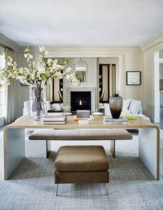 A library table divides the living room's two seating areas, while an area rug ties the spaces together. Desk In Living Room, Living Room Seating, Formal Living Rooms, Living Room Kitchen, Home And Living, Living Room And Kitchen Together, Living Room Decor 2018, Modern Living, Living Room Remodel