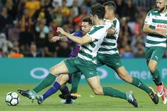 Barcelona's forward from Argentina Lionel Messi (L) vies with Eibar's defender from Portugal Paulo Oliveira (C) and Eibar's defender from Spain David Junca during the Spanish league football match FC Barcelona against SD Eibar at the Camp Nou stadium in Barcelona on September 19, 2017. / AFP PHOTO / PAU BARRENA