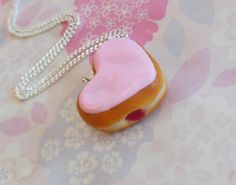 This little donut is around 1 long, sculpted from polymer clay  Pink, heart shaped, perfect for your valentine!    choose your chain type at
