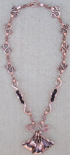 Necklace | forged copper necklace - more spirals; almost figure 8's as links. Ends of these links plannished to curve easily.