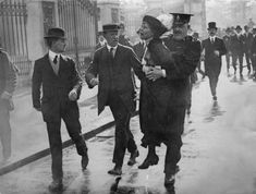 Emmeline Pankhurst (1858 - 1928), a British suffragette, is arrested during a protest outside Buckingham Palace.
