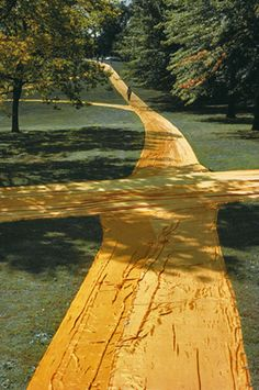 """With """"Wrapped Walk Ways"""" Christo and Jeanne-Claude covered 4.5 km of footpaths in Loose Park, a park in Kansas City, Missouri. Altogether it required 12,500 m2 of orange-yellow-coloured shiny nylon fabric. Pedestrians enjoyed the artwork for two weeks in October. The cost of this project amounted to $130,000. 1977-1978."""