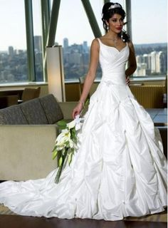 princess ball gown pick up wedding dress straps.  I love the top of this dress.. not crazy about the bottom though.
