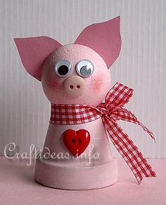 Cute bell-pig.  - 35 mm styrofoam ball (approximately 1.4 inches)  - clay pot 40 mm high (approximately 1.6 inches high)  - pink construction paper or cardstock  - pink button  - 2 x 10mm wiggly eyes  - pink acrylic paint  - red paint, stiff round brush and piece of paper towel (for cheeks)  - red checked ribbon  - red heart button or other button of choice  - strong craft glue  - kitchen knife.