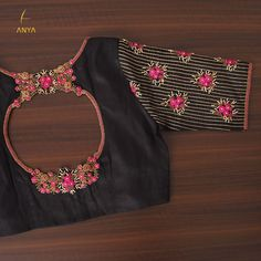 A unique neck design made with thread antique bead kundhan and antique sequins is accompanied by a sleeve of the same work. The rich black of this blouse enhances the beauty of this gorgeous piece. 23 January 2020 Source by acheivermahesh designs Blouse Back Neck Designs, Cutwork Blouse Designs, Wedding Saree Blouse Designs, Best Blouse Designs, Simple Blouse Designs, Stylish Blouse Design, Indian Blouse Designs, Blouse Designs Catalogue, Designer Blouse Patterns