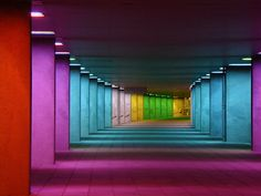Concrete Columns Light up to Create a Rainbow Hallway