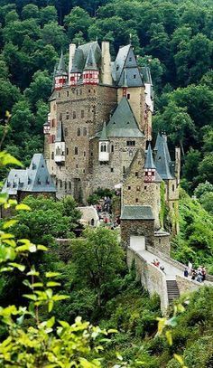 Burg Eltz castle Burg Eltz is a medieval castle nestled in the hills above the Moselle River between Koblenz and Trier, Germany. It is still owned by a branch of the same family that lived there in the century, 33 generations ago. Places Around The World, Oh The Places You'll Go, Places To Travel, Places To Visit, Around The Worlds, Beautiful Castles, Beautiful Buildings, Beautiful World, Beautiful Places