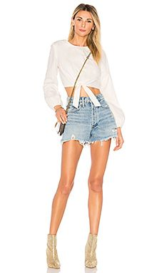 Shop for Women's Designer Clothing at REVOLVE CLOTHING. Find this season's must-have designer dresses, jeans, tops, jackets & more from top designer brands! Honeymoon Outfits, Honeymoon Clothes, Cold Front, Long Sleeve Tops, Curvy, Tie, Model, Shirts, Shopping