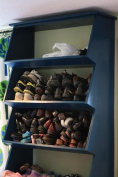 Floor to Ceiling! Now this is what I call shoe storage! We could easily make this out of plywood and stain or paint it!!