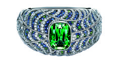 Tiffany & Co.'s Making Waves bracelet features 532 sapphires and 90 tsavorites hand set in platinum with more than 1,324 round brilliant-cut diamonds. The center stone is a 45.55-carat cushion-cut green tourmaline ($395,000).