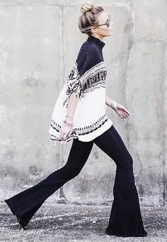 a cozy knit sweater and flared jeans.