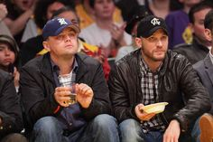 He contemplates life with Tom Hardy. | 26 Things That Happen When Leonardo DiCaprio Goes To A Basketball Game