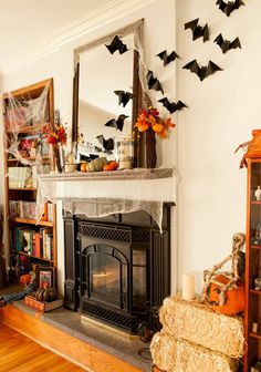Halloween fireplace decor, neat idea with the bats