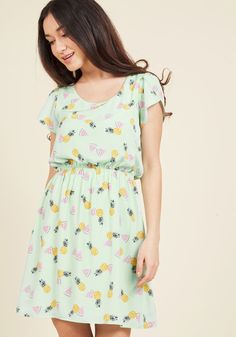 <p>Expressing your delight will be automatic as soon as you slip into this printed dress - a ModCloth exclusive! A bevy of watermelon slices and pineapples float across this cheerful mint frock, adding a touch of whimsy to its tulip sleeves and adorably cinched waist.</p>