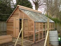 I like the idea of a combo potting shed greenhouse The Grand Grow Store