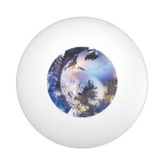 #christmas #zazzle Blue ice colored Christmas ornament on the tree with bokeh lights.