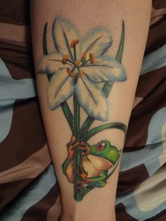 "White lilly and frog tattoo done at Craven Ink in Greeneville, TN by Brandon ""Rat"" Craven-the owner of the shop"