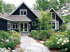 charcoal gray cottage house with white trim flagstone path garden, via cococozy