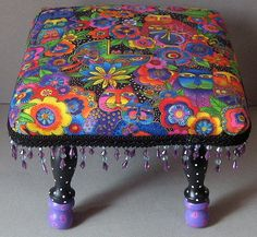 Colorful Kitties Footstool. $98.00, via Etsy.    And she also is looking for some new office furniture.