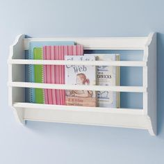 Storage option in a tight nursery...it would work right next to the glider!  (Bin There Done That Book Bin from landofnod.com)