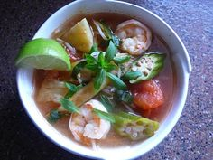 Had this last night and can't stop thinking about how delicious it tastes! This is Canh Chua which literally translates into 'Sour Soup'. It's a tamarind flavoured soup with tomatoes, pineapple and prawns.