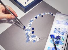 Cushion-cut sapphires and a sketch of the Graff Diamonds jewelry set which will be exhibited in Monaco
