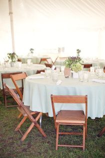crisp white linens, garden-y centerpieces and wooden folding chairs: this is the look we want! (with long tables instead)