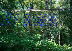 Stained glass & wire screen for a stunning garden wall. Add vines or a climbing flower to have the colors poo through with the sun. How pretty!