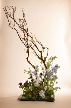 Buffet arrangement made with anemones, larkspur, berzillia, hydrangea and manzanita. Created by Christopher Flowers