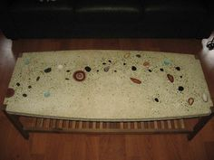 Concrete coffee table, with inlaid agate slices, cut stones, and projector lenses; the aggregate is crushed glass rather than pebbles - by goyo81 [Instructables]